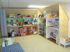 American girl dollhouse-- Wow! I am an adult and would enjoy playing with my girls if they had this!