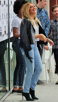 Laughs: The High School Musical star teamed a blue and white breton striped top with high-waisted pale blue jeans