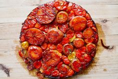 Ottolenghi's Plenty Cookbook: Surprise Tatin is something truly spectacular, a crown jewel for the dinner table. It, much like its sweeter namesake, involves a puddle of dark caramel and pillowy puff pastry. But instead of the usual apples tucked beneath that buttery lid, it's roasted cherry tomato halves, itty bitty potatoes, sweet onions, and semi-firm goat's cheese that bubble away together in the heat of the oven.