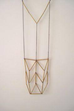 Totem necklace.