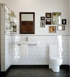 Classic black and white bathroom. Fantastic stripe of black bordering the end of the white tiles. Bad Inspiration, Bathroom Inspiration, Modern Bathroom Design, Bathroom Interior Design, Eclectic Bathroom, Bathroom Designs, Scandinavian Bathroom, Bath Design, Eclectic Decor