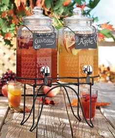 >p style='margin-bottom:0px;'>Quench the family's thirst in sophisticated style. Filled with iced tea or lemonade, this set of two glass dispensers is just the thing for keeping cool on hot summer days. A rack and two chalkboard place cards are included, making this set a must-have for those who love to entertain. Includes two dispensers, two chalkboards and rack  Rack: 7'' H