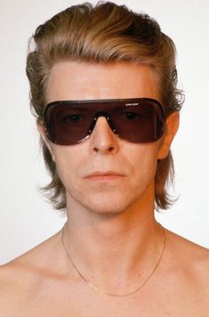 """""""Tomorrow belongs to those who can hear it coming."""" — David Bowie wearing the Porche glasses Yoko Ono..."""