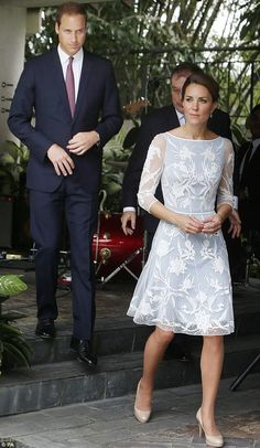 The show must go on: Prince William cannot hide his anger as he joins his wife at a tea party in their honour in Kuala Lumpur