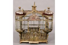 Antique French tole bird cage in the form of a chateau with shaped roof line and turreted sides circa 1910