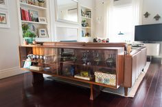 The vintage rosewood credenza shows off collectibles. It's from Guff Furniture in Toronto. dredenza for behind couch Couches For Small Spaces, Behind Couch, Sofa, Furniture Upholstery, Mid Century House, Home Living Room, Home Decor Inspiration, Sideboard, House Tours