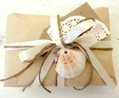 Brown Paper Gift Wrapping with Twine, Ribbon and Shell.
