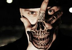 Hand Face Tattoo