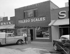 """Toledo Scales and Clayton's Hobby Shop were located at 1779 on Ft. Henry Drive. Clayton's Hobby Shop was owned by Arthur F. Clayton. The """"S"""" on the building next door is the beginning of the sign for Skateland. Skateland was owned by Ray McCoy."""