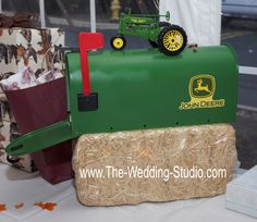 Green & yellow John Deere mailbox with tractor on top used to collect envelopes at country themed wedding. The Wedding Studio, Schaumburg IL