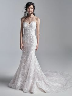 Don't let the classic silhouette fool you. This strapless embroidered mermaid wedding gown delights in texture, shimmer, and fit. (A major statement need not be limited to the ostentatious.) Dream Wedding Dresses, Bridal Dresses, Wedding Gowns, Prom Dresses, Bridal Gown, Wedding Bells, Maggie Sottero, Sottero And Midgley Wedding Dresses, Sottero Midgley