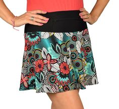 """SwingStyle TropicalBreeze Breeze into a tropical vacation mood with this tasty treat!  Medium-weight tropical print covers black wicking, anti-ride undershorts which feature cute mini polka-dot cuffs and 5X5"""" pockets.  Wear the 12"""" zippered waistband pocket front or back, your choice!"""