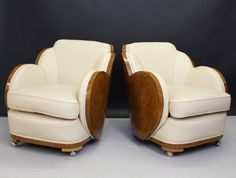 A pair of Art Deco cloud back armchairs, part of a three piece suite comprising sofa and 2 chairs. Walnut backed and upholstered in rich cream leather. Harry and Lou Epstein. English. c. 1930. (hva)