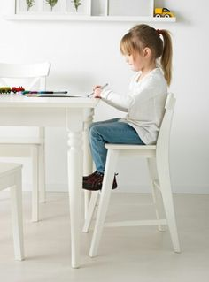 ikea ingolf junior chair white gives the right seat height for the child at the dining table
