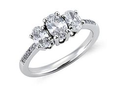 Oval-cut diamond three-stone pave (1 carat total weight) engagement ring set in 18-karat white gold.    $2,400, bluenile.com