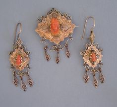 VICTORIAN 10k coral cameo brooch and earrings, brooch has watch holder hook on the back