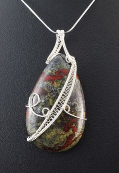 A unique, handmade, wire wrapped pendant with Bloodstone.  Pendant was designed and made by Me, using an extremely labor-intensive and precise wire-wrapping technique, with silver 925, 930 and 999.  Dimensions of pendant: length: 6,2 cm 2.44 inch width: 3,1 cm 1.22 inch  You receive this unique pendant in jewelry box, so it is ready to be a gift.  ---On this auction You buy ONLY pendant without chain.----   Refunds and Exchanges:  If you are not satisfied with your purchase for any reason…