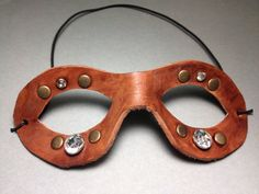 Leather fitted mask with rhinestones and rivets by TheDeviousFox, $18.00