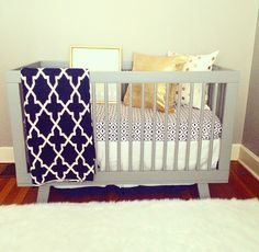 Bennett's crib! I decided to go with a grey, navy, gold color scheme. Love the Babyletto Hudson crib I decided on!