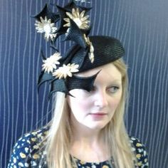 Matthew Eluwande Millinery. This great piece and more at http://www.fashionattheraces.com/store