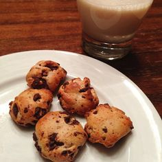 """Chocolate Chip """"Cookies"""" // Chocolate Chip Cookie Dough Quest bar cut and rolled into discs and baked until edges are browned. Dip in almond milk. Yum!"""