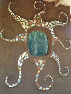 Another sun at #mamaroja this time around a window using mosaic tiles. Sculpted by Jax.