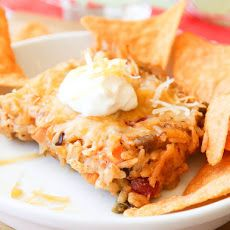 Cheesy Taco Casserole Recipe Main Dishes with cooked rice, salsa, veggies, beans, taco seasoning, sour cream, shredded cheese