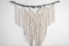 Large Macrame Wall hanging  A fusion knots and of course lots of fringing! The star of this piece is a beautiful long branch.  Your piece is made by hand using natural unbleached cotton and revived branches from local woods in Upstate NY and the Adirondacks. ✨✨✨  SIZING She measures roughly 44in x 45in (including the branch) so she is sure to stand out wherever you choose to hang her.  Sizing is approximate: Branch Width - 44 Macrame Length - 44 Rope hanger- 5  ✨✨✨  MADE TO ORDER  I will…