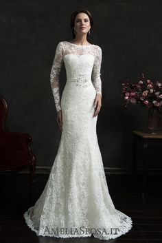 Wedding dress Novia - AmeliaSposa. Clean elegant chic implemented in a clinging silhouette. Gorgeous laces surround a body with the finest and thinnest net focusing your attention on a naked back. A perfect choice for confident ladies who behave as queens in any situation.