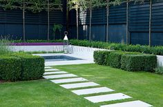 Spa Garden | Stepping stone path to terrace with spa | Charlotte Rowe Garden Design