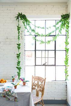 Drape a vine like a curtain.
