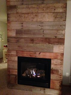 Reclaimed barn wood fireplace makeover!