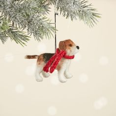 """Man's best friend is just waiting to jump on your tree! This big-mouthed beagle is hand-felted by artisans in Nepal, and has little black bead eyes and a long wagging tail. Plus, a darling hand-knit scarf keeps him warm. A must-have for any dog lover. Comes with attached hanging loop. Dimensions: 3 1/2""""h. Holiday Gifts, Holiday Decor, Hand Knit Scarf, Green Gifts, Gift Certificates, Mans Best Friend, Beagle, Gift Baskets, Nepal"""