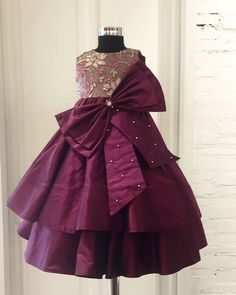 A rich double layered wine taffeta elegant gown teamed up with a shear self work torso emblisshed with swaroski stones and a enhanced with a big bow! for enquiries: 09347276013 Baby Girl Dress Patterns, Baby Dress Design, Frock Design, Kids Frocks Design, Baby Frocks Designs, Kids Gown Design, Baby Girl Party Dresses, Dresses Kids Girl, Baby Girl Gowns