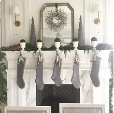 Gray and white Christmas. Gray and white Christmas Decor. Gray and white Christmas Decor Ideas. Gray and white Christmas Mantel Decor. Gray stocking are from Ballard Designs. Caitlin Creer Interiors.