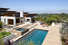 Google Image Result for http://www.interiorarcade.com/images-pictures/2010/07/lavish-luxurious-hilltop-house-exterior-swimming-pool.jpg