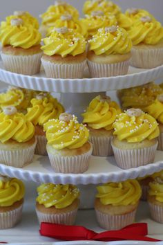 Mini-cupcakes with yellow icing and a single Cheerio on top