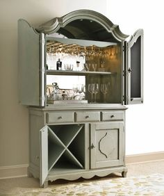 Armoire mini bar: Ours is simmilar to the pic. Still need to find a mirror for the back and a rack to hang the glasses from. It is an awesome way to repurpose a huge and expensive peice of furniture.