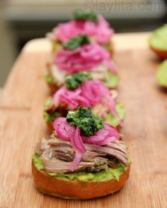 Roast pork sliders with avocado spread, pickled onions and cilantro hot sauce