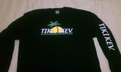 Tiki Kev long sleeve black shop shirt. ( Front ) For more info go to www.tikikev.com or call 800-792-8454