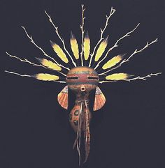 kachina Mask with inlaid earrings and feather and branch headress by robert rivera
