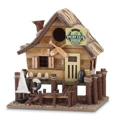 "Features:  -Birdhouse.  -Constructed of wood.  Product Type: -Birdhouse.  Mount Type: -Freestanding.  Style: -Cottage. Dimensions:  Overall Height - Top to Bottom: -10"".  Overall Width - Side to Side:"