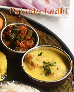 Pakodas made with besan, dunked in dahi kadhi makes a delicious accompaniment for rice. Pair it up with a spicy curry, this easy kadhi can be made in a jiffy. North Indian Recipes, Indian Food Recipes, Punjabi Recipes, Ethnic Recipes, Lunch Menu, Breakfast Lunch Dinner, Veg Recipes, Dinner Recipes, Punjabi Food