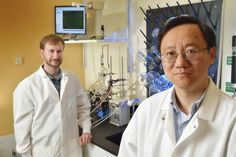 Dr. Percival Zhang (right) and Dr. Joe Rollin in front of their device...VT at the forefront of green fuels..