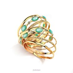 Just Jewelry Mint to be Stacked- Nine rows of golden, rhinestone, and teal bangles will make a fun statement this season. Wear it combined for a stunning statement, or break it down for a subtle look that suits your mood.-$24