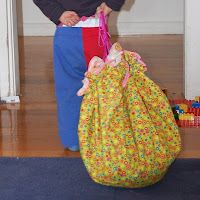 DIY Swoop Bag tutorial. For all those teeny tiny toys, that are a pain in the butt to pick up. When the bag is open, it's a play mat. When they're done playing, they just pull the drawstrings and the toys are neatly stored.