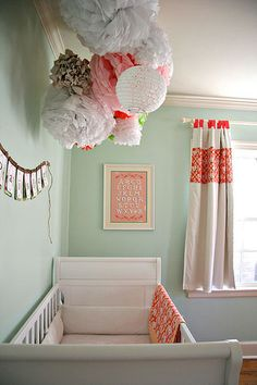 baby blue and coral or orange. This wall color would be really easy to work with regardless of gender.
