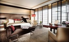 Four Seasons Hotel, Shanghai, China  Wallpaper's Best Business Hotels 2012.  The Four Seasons Pudong is the hotel group's second property in Shanghai – a sign of just how bullish the Four Seasons is about China in general and Shanghai in particular. The new build is located in Pudong, Shanghai's financial and commercial hub on the east side of the Huangpu River, and just across from the historic city centre.