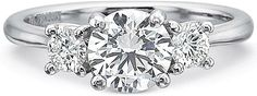 Precision Set Three Stone Diamond Engagement Ring Setting  : This diamond engagement ring setting by Precision Set features a round brilliant cut diamond on each side of the center stone of your choice.