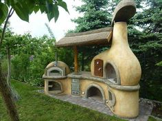 Outdoor kitchen made from cob. Perfect for summer cooking and canning! Oh man, definitely need one!